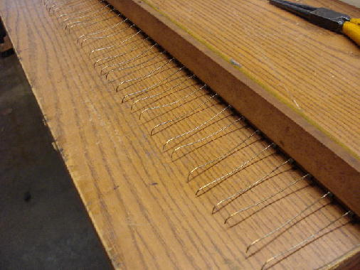 22 - Clean & lubricate hammer rail springs