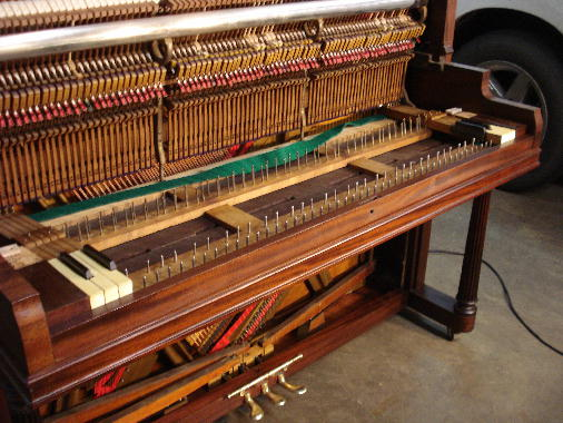 60 - Keys, punchings, blocks, keyslip dry-fitted at both ends of piano
